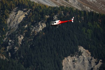 A rescue helicopter flies near Sion Switzerland