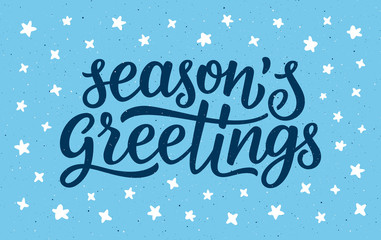 Seasons greetings calligraphy lettering text on blue background with white doodle stars. Retro greeting card for Christmas and New Year holidays. Vector background