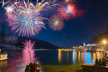 Limone sul Garda,Lago di Garda ,Italy - 03 September 2017:Beautiful firework display for celebration on the Grda Lake,italy,Brightly Colorful Fireworks