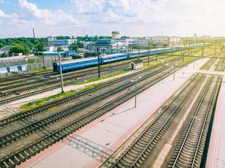 Train, Platform And Tracks At Railway Station