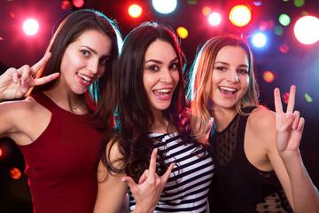 Girls fun posing at a party