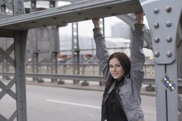 Young woman on Hacker Bridge, Munich, Bavaria, Germany