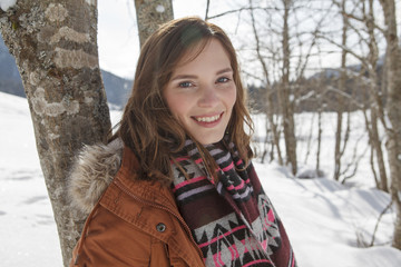 Young woman smiling at camera, Spitzingsee, Upper Bavaria, Germany