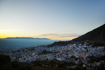 Evening sky covers little city with white houses in Morocco