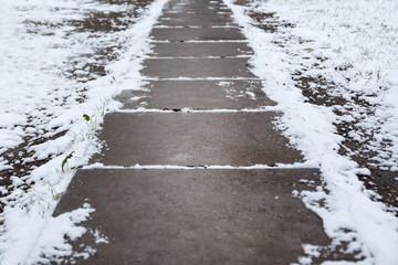 snow-covered concrete path
