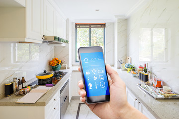 smart phone with smart home with modern kitchen