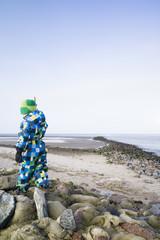Boy walking on the beach, Cuxhaven, North Sea, Lower Saxony, Germany