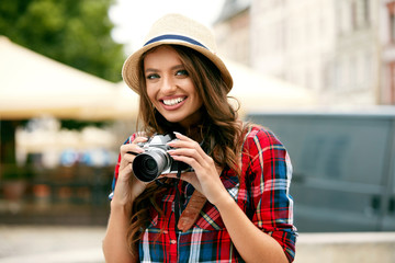Tourist Woman With Camera Taking Photos Of Beautiful Location