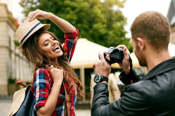 Couple In Love. Man Taking Photos Of Beautiful Woman In Street.