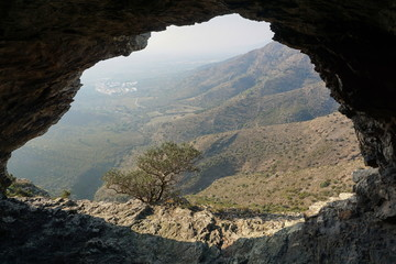 View of a valley from inside a cave near the city of Roses, Alt Emporda, Girona, Catalonia, Spain