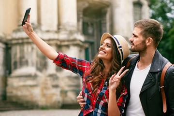 Lovely Tourist Couple Taking Photos On Phone On Street