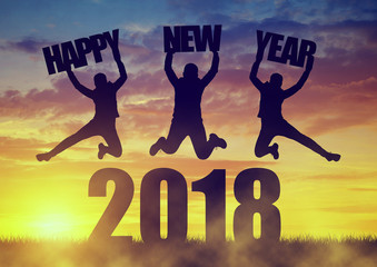 Silhouette of a girls jumps up while celebrating New Year 2018.