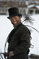 Germany, portrait of chimney sweep with top hat