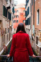 Cinque Terre Italy embankment. concept of relaxing at sea. girl at the sea. cold girl dressed in a red coat