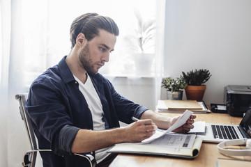 Men Reading at Office
