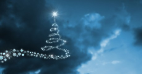 Snowflake Christmas tree pattern shape glowing in sky
