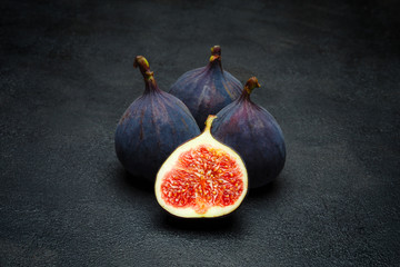 Fig isolated on dark concrete background Wall mural
