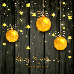 Gold Christmas balls and stars on black wooden background