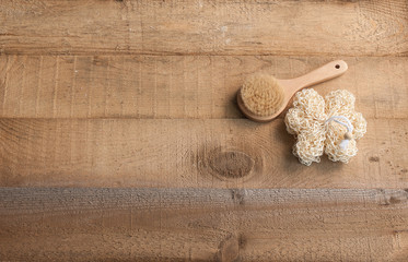 spa center brush and soap style wooden background