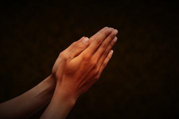 hand praying with dark background