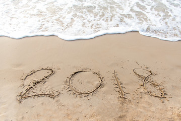 Written 2018 on the sand of a beach for happy new year.  Travel Concept
