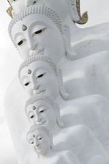 couple peaceful white buddha statues sitting well alignment and decorating wonderful attractive mirror, one of the most interesting landmark in north of Thailand , home decoration picture
