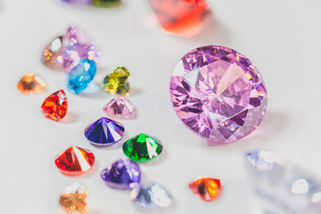 Wall Mural - colorful gemstones are displayed on the white floor