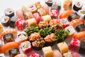 Set of sushi, maki and rolls background