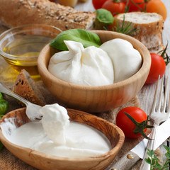 Italian cheese burrata with bread, vegetables and herbs