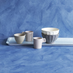 glass and tray concept blue background