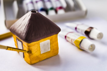 To paint ceramic house with acrylic paints