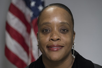 Portrait of a female African American judge in a black robe