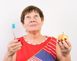 grandma brushing her teeth with a brush