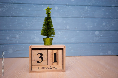 december 31st day 31 of december set on wooden calendar on blue wooden plank background
