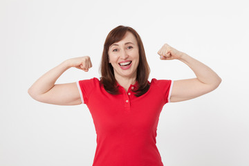 Strong woman showing her muscularity and looking at camera isolated on white. Copy space and blank shirt. Mother day