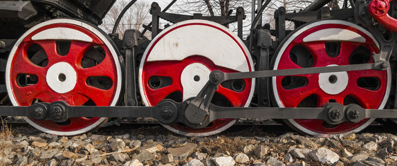 Steam locomotive wheels close-up. Fragment of the old locomotive
