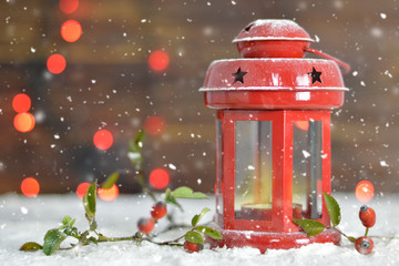Christmas card with Christmas lantern on wooden background
