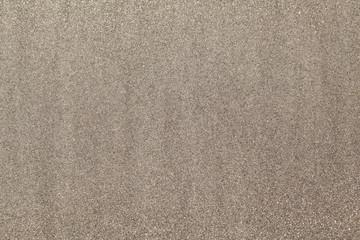 Textured wet sand background