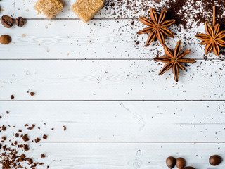 Background with different coffee, coffee bean, earth, and instantly, chocolate, brown sugar and star anise, copy space, top view.