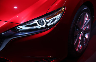 Detail view of a headlight on the new Mazda 6 at the Los Angeles Auto Show in Los Angeles