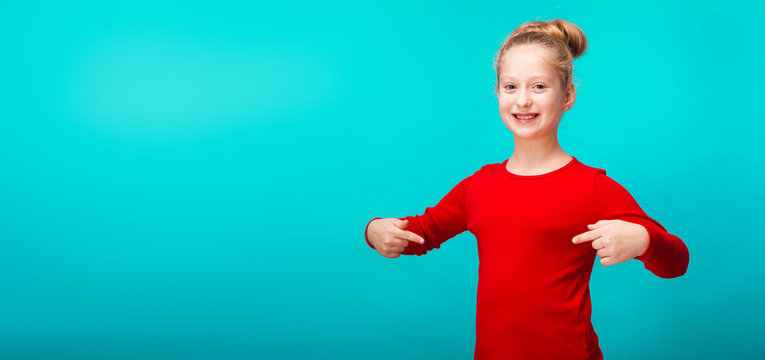 smiling little girl on blue background