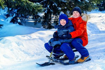boys sledding from a hill