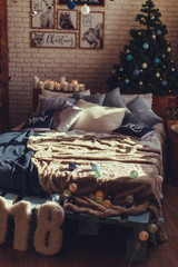 Christmas interior bedroom. Cozy and stylish modern room