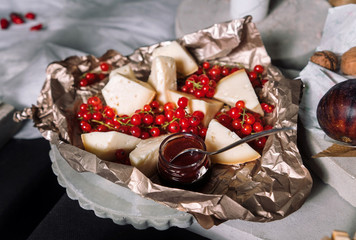 Cheese, red currants.