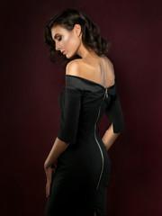 Young beautiful woman wearing black evening dress