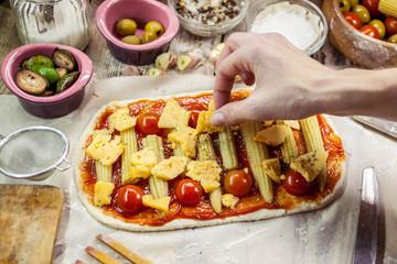 Woman makes vegetarian pizza. Vegetarian dish. Meatless food. Mediterranean cuisine. Selective focus. Easy toning