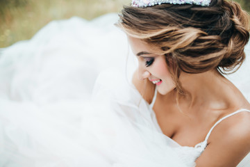 Beautiful young bride is smiling.