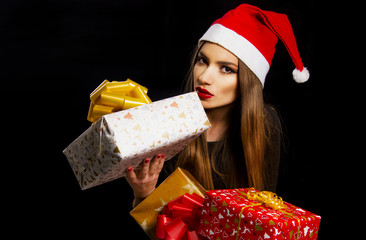 girl with presents and santa red hat