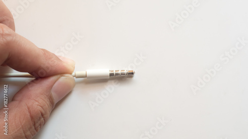 Wall mural hand with earphone close up on white background