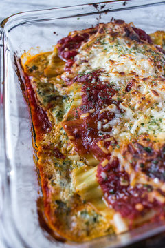 Italian manicotti with cheese and red sauce dish